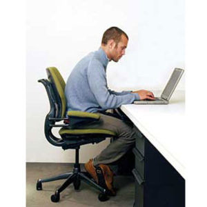 desk worker with bad posture