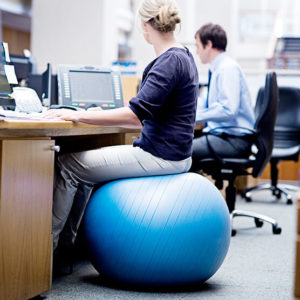 lady sitting on a swiss ball chair