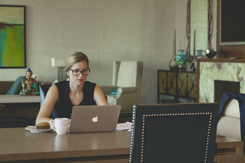 women focused on a laptop but not posture